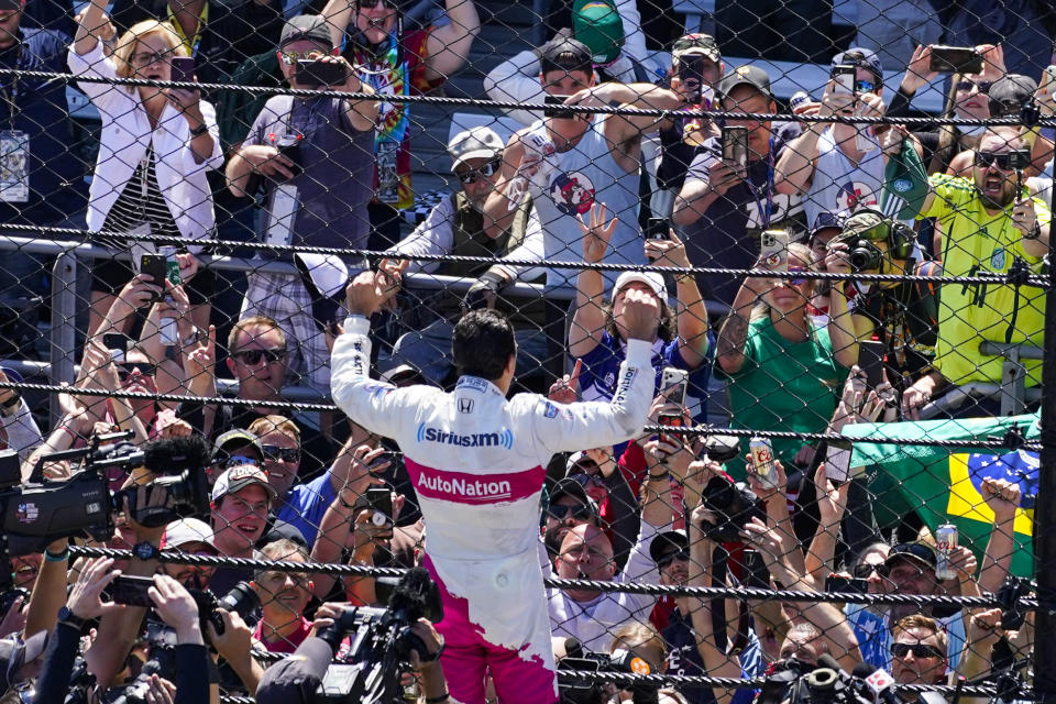 Helio Castroneves of Brazil celebrates after winning the Indianapolis 500 auto race at Indianapolis Motor Speedway in Indianapolis, Sunday, May 30, 2021. (AP Photo/Darron Cummings)