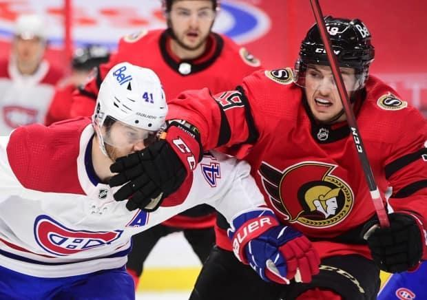 Ottawa Senators right wing Drake Batherson (19) gives Montreal Canadiens left wing Paul Byron (41) a facewash during first-period NHL action in Ottawa on Feb. 6, 2021.