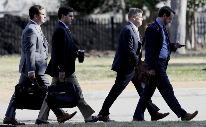 Virginia Speaker of the House Kirk Cox, second from the right, arrives at the Virginia State Capitol, Wednesday, Feb. 6, 2019, in Richmond, Va. (Steve Earley/The Virginian-Pilot via AP)