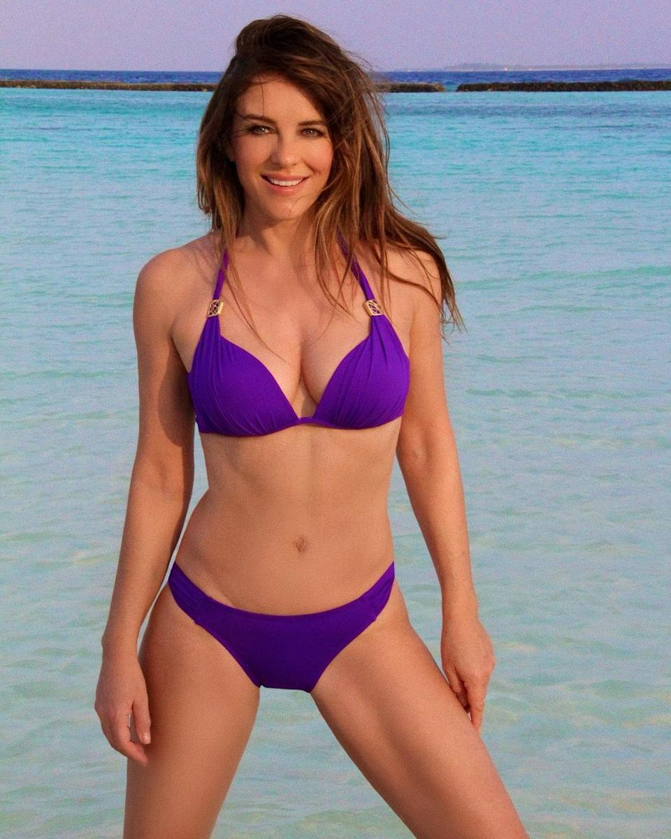 Elizabeth Hurley in a purple bikini on the beach