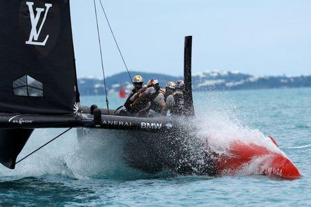 Sailing - America's Cup finals - Hamilton, Bermuda - June 24, 2017 - Oracle Team USA crosses finish line to beat Emirates Team New Zealand in race six of America's Cup finals.  REUTERS/Mike Segar     TPX IMAGES OF THE DAY