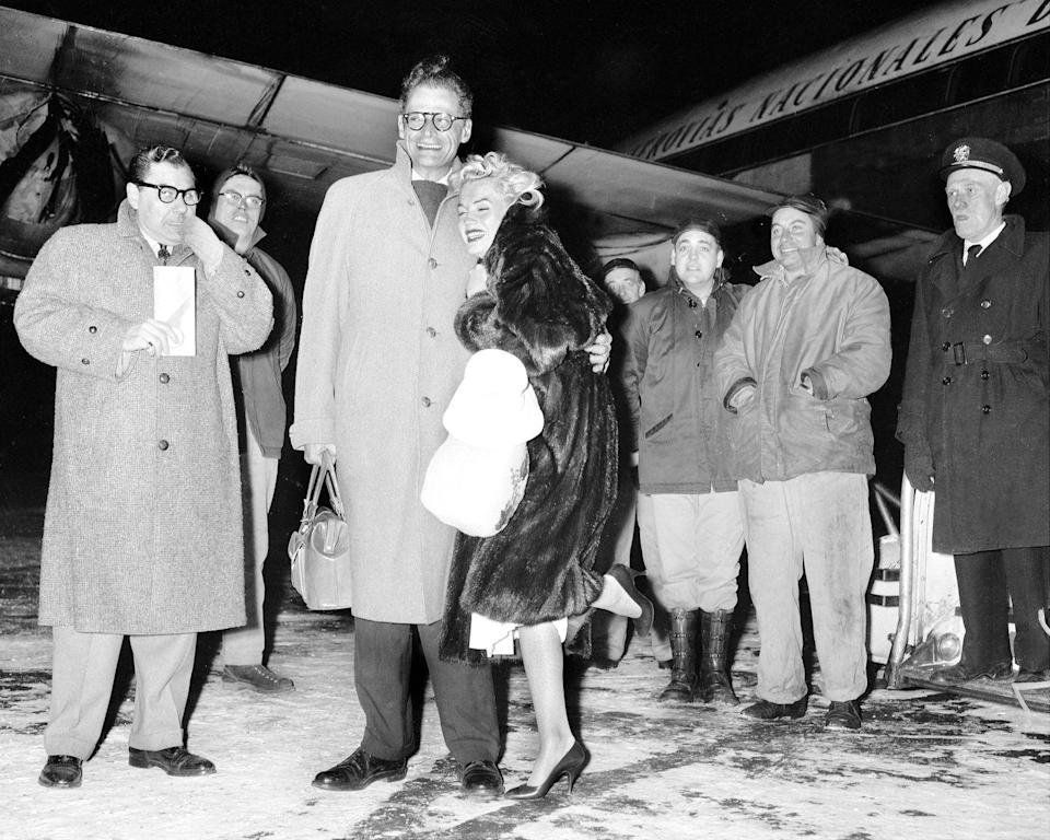 <p>Marilyn Monroe and her husband, Arthur Miller, arrive in New York City bundled up after spending the holidays in Jamaica. </p>