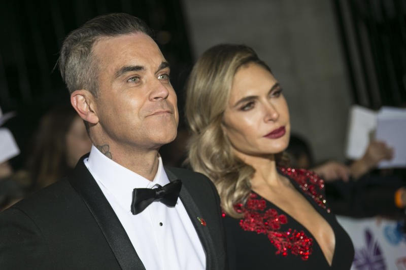 Singer Robbie Williams, left, and his wife and Ayda Field posesfor photographers upon arrival for the Pride of Britain Awards at a central London hotel, Monday, Oct. 29, 2018. (Photo by Joel C Ryan/Invision/AP)