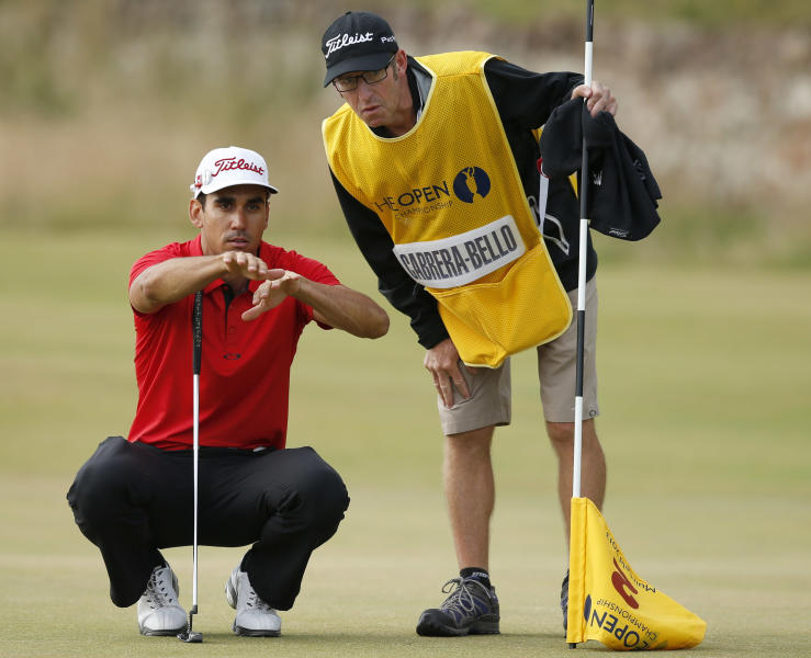 Rafael Cabrera-Bello of Spain lines up a putt on the second green with his caddie Mike Batty during the first round of the British Open Golf Championship at Muirfield, Scotland, Thursday July 18, 2013. (AP Photo/Matt Dunham)