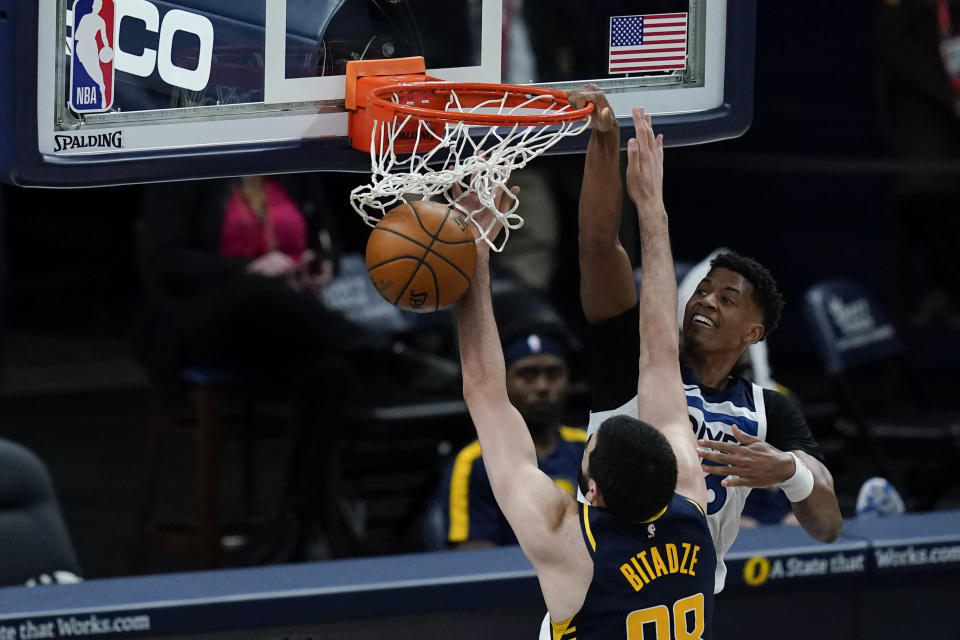 Minnesota Timberwolves' Jarrett Culver (23) dunks against Indiana Pacers' Goga Bitadze (88) during the second half of an NBA basketball game, Wednesday, April 7, 2021, in Indianapolis. (AP Photo/Darron Cummings)