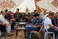 Relatives of 17-year-old Mohammed Jawawdeh, who was shot dead by an Israeli security guard after he attacked him with a screwdriver at the Israeli embassy compound, gather in a mourning tent in the capital Amman on July 24, 2017