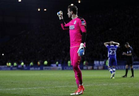 Britain Football Soccer - Sheffield Wednesday v Huddersfield Town - Sky Bet Championship Play Off Semi Final Second Leg - Hillsborough - 17/5/17 Huddersfield Town's Danny Ward gestures as Sheffield Wednesday's Sam Hutchinson looks dejected after missing a penalty Action Images via Reuters / Lee Smith