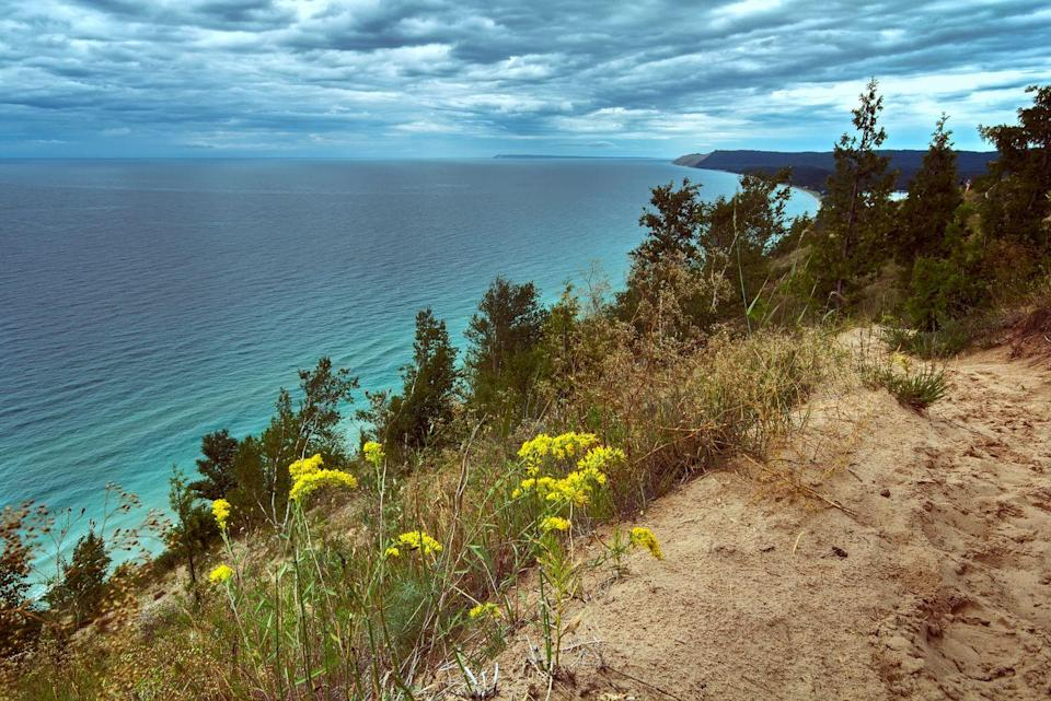 """<p>Located in the Sleeping Bear Dunes, visitors enjoy the 1.5-mile <a href=""""https://www.tripadvisor.com/Attraction_Review-g42182-d269478-Reviews-Empire_Bluff_Trail-Empire_Leelanau_County_Michigan.html"""" rel=""""nofollow noopener"""" target=""""_blank"""" data-ylk=""""slk:Empire Bluff Trail"""" class=""""link rapid-noclick-resp"""">Empire Bluff Trail</a>, a combination of dirt trails and boardwalks that lead to a bluff where you can take in a panoramic view of Lake Michigan.</p><p><br><a class=""""link rapid-noclick-resp"""" href=""""https://go.redirectingat.com?id=74968X1596630&url=https%3A%2F%2Fwww.tripadvisor.com%2FAttraction_Review-g42182-d269478-Reviews-Empire_Bluff_Trail-Empire_Leelanau_County_Michigan.html&sref=https%3A%2F%2Fwww.countryliving.com%2Flife%2Ftravel%2Fg24487731%2Fbest-hikes-in-the-us%2F"""" rel=""""nofollow noopener"""" target=""""_blank"""" data-ylk=""""slk:PLAN YOUR HIKE"""">PLAN YOUR HIKE</a></p>"""