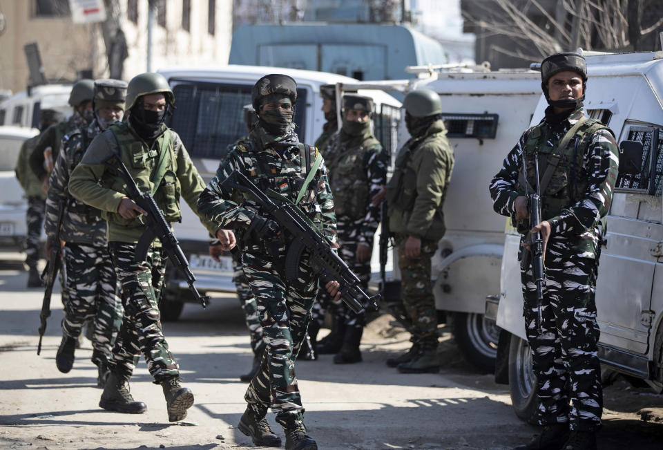 Indian paramilitary soldiers arrive at the site of a shootout in Srinagar, Indian controlled Kashmir, Friday, Feb. 19, 2021. Anti-India rebels in Indian-controlled Kashmir killed two police officers in an attack Friday in the disputed region's main city, officials said. Elsewhere in the Himalayan region, three suspected rebels and a policeman were killed in two gunbattles. (AP Photo/Mukhtar Khan)
