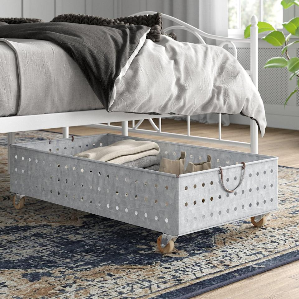 "<p>The rolling <a href=""https://www.popsugar.com/buy/Galvanized-MetalWire-Underbed-Storage-571589?p_name=Galvanized%20Metal%2FWire%20Underbed%20Storage&retailer=wayfair.com&pid=571589&price=100&evar1=casa%3Aus&evar9=46502982&evar98=https%3A%2F%2Fwww.popsugar.com%2Fphoto-gallery%2F46502982%2Fimage%2F47545978%2FGalvanized-MetalWire-Underbed-Storage&list1=shopping%2Cfurniture%2Corganization%2Cbedrooms%2Csmall%20space%20living%2Chome%20organization&prop13=api&pdata=1"" class=""link rapid-noclick-resp"" rel=""nofollow noopener"" target=""_blank"" data-ylk=""slk:Galvanized Metal/Wire Underbed Storage"">Galvanized Metal/Wire Underbed Storage</a> ($100) box is so useful.</p>"