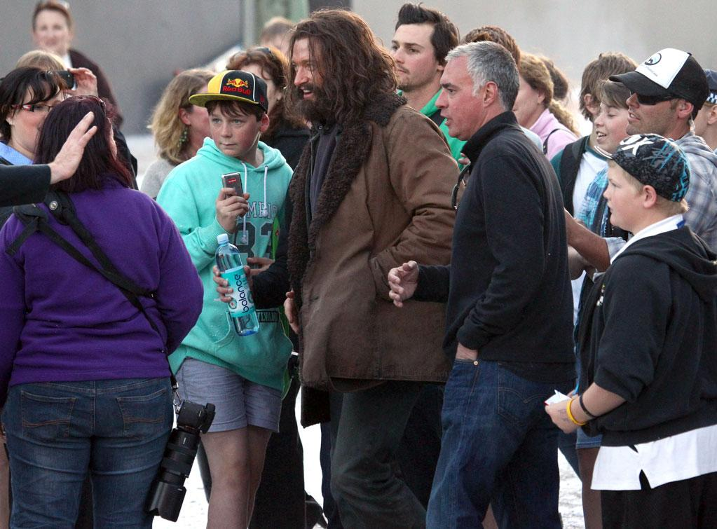 """<b>Hairy Monster</b><br><br>Hugh Jackman looks nearly unrecognizable as he channels his inner vagrant to act in """"The Wolverine."""" <br><br>Hugh was mobbed by excited fans between takes, and he happily took time out to pose for pictures and sign autographs on Friday, Aug. 3."""