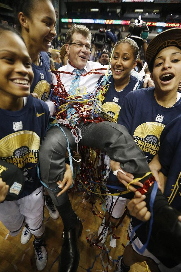 Connecticut players carry Connecticut head coach Geno Auriemma after the second half of the championship game against Notre Dame in the Final Four of the NCAA women's college basketball tournament, Tuesday, April 8, 2014, in Nashville, Tenn. Connecticut won 79-58. (AP Photo/John Bazemore)