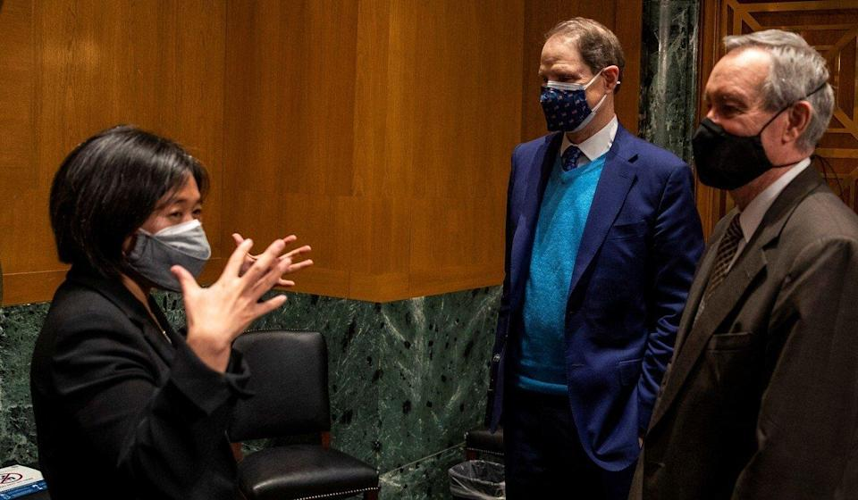 Tai speaking with the Senate Finance Committee chairman Ron Wyden and Senator Michael Crapo after the hearing on Thursday. Photo: Reuters