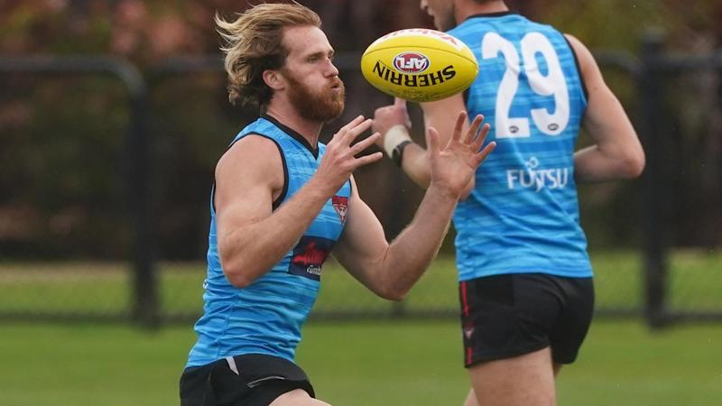 Essendon AFL player James Stewart will have to self-isolate under COVID-19 restrictions
