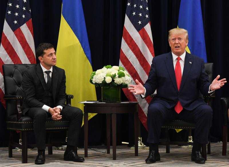 US President Donald Trump speaks as Ukrainian President Volodymyr Zelensky looks on during a meeting in New York on September 25, 2019, on the sidelines of the United Nations General Assembly. (Photo: Saul Loeb/AFP/Getty Images)