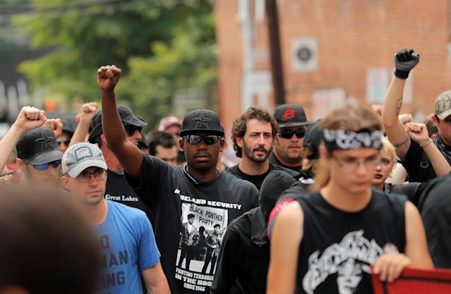"<p>A group wearing antifa paraphernalia march ahead of the one year anniversary of 2017 Charlottesville ""Unite the Right"" protests in Charlottesville, Va., Aug. 11, 2018. (Photo: Lucas Jackson/Reuters) </p>"