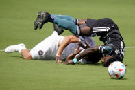 LA Galaxy defender Oniel Fisher, right, and Inter Miami midfielder Rodolfo Pizarro, left, collide during the first half of an MLS soccer match, Sunday, April 18, 2021, in Fort Lauderdale, Fla. (AP Photo/Lynne Sladky)
