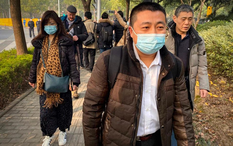Lawyer Ren Quanniu (C), representing Chinese citizen journalist Zhang Zhan who reported on Wuhan's Covid-19 outbreak - AFP