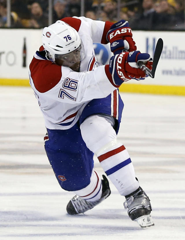 Montreal Canadiens' P.K. Subban follows through on his game-winning goal in the second overtime period against the Boston Bruins in Game 1 of an NHL hockey second-round playoff series in Boston, Thursday, May 1, 2014. The Canadiens won 4-3. (AP Photo/Elise Amendola)