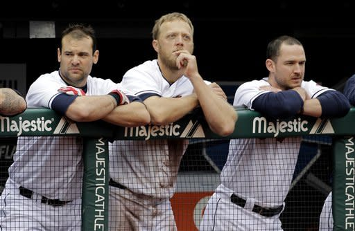 Cleveland Indians, from left, first baseman Casey Kotchman, left fielder Shelley Duncan, and third baseman Jack Hannahan watch from the dugout rail during the ninth inning of their 4-2 loss to the Kansas City Royals in a baseball game in Cleveland on Thursday, April 26, 2012. (AP Photo/Amy Sancetta)