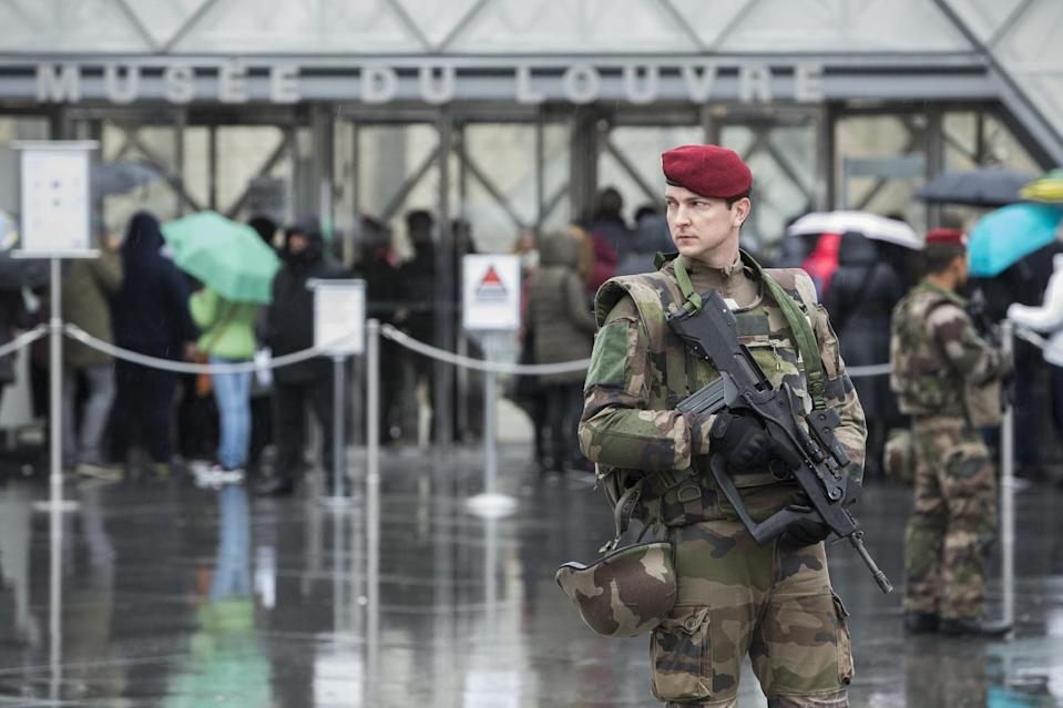 """A French soldier patrols in the courtyard of the Louvre museum with the visitor control in background in Paris, Saturday, Feb. 4, 2017. The Louvre in Paris reopened to the public Saturday morning, less than 24-hours after a machete-wielding assailant shouting """"Allahu Akbar!"""" was shot by soldiers, in what officials described as a suspected terror attack.(AP Photo/Kamil Zihnioglu)"""