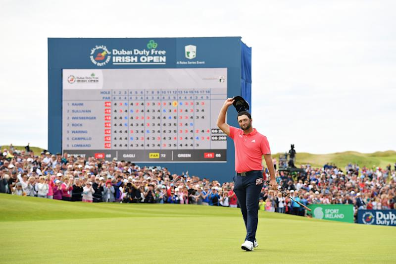 Jon Rahm waves to the crowd after his putt on the eighteenth hole during the final round of the 2019 Dubai Duty Free Irish Open.