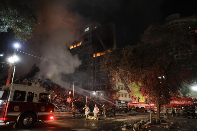 <p>Firefighters work at the scene of a building that caught fire and collapsed in Sao Paulo, Brazil, Tuesday, May 1, 2018. (Photo: Andre Penner/AP) </p>