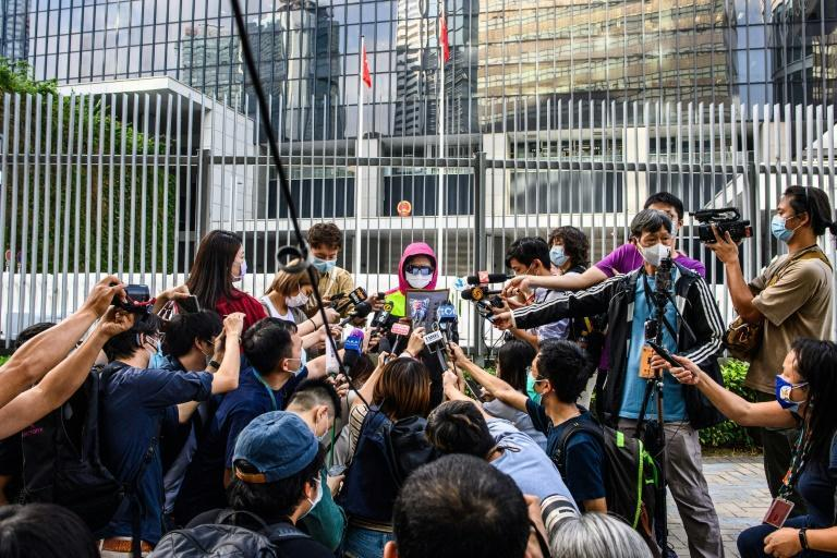 Poon's mother (C) has cut a tragic figure, shuttling between Hong Kong ministries and urging officials to break the legal deadlock on Chan's extradtion to Taiwan