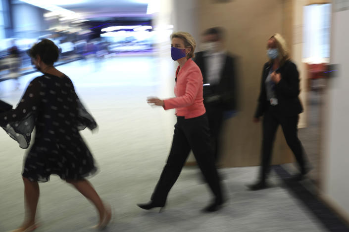 European Commission President Ursula von der Leyen, center, arrives for a plenary session ahead of her first State of the Union speech at the European Parliament in Brussels, Wednesday, Sept. 16, 2020. European Commission President Ursula von der Leyen will set out her vision of the future in her first State of the European Union address to the EU legislators. Weakened by the COVID-19 pandemic and the departure of the United Kingdom, she will center her speech on how the bloc should adapt to the challenges of the future, including global warming, the switch to a digital economy and immigration. (AP Photo, Francisco Seco)