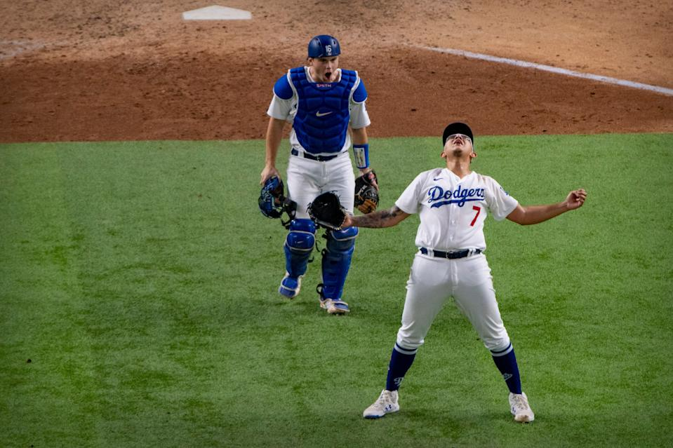 NLCS Game 7: Julio Urias celebrates the final out.