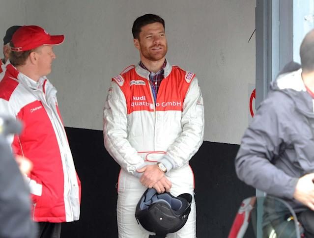 MADRID, SPAIN - NOVEMBER 08: Real Madrid player Xabi Alonso (R) attends Real Madrid and Audi event at the Jarama recetrack on November 8, 2012 in Madrid, Spain. (Photo by Fotonoticias/WireImage)