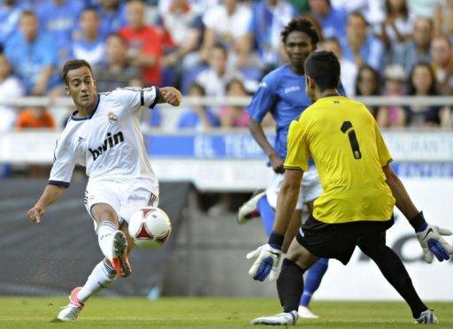 Real Madrid's Lucas (L) scores the opening goal past Real Oviedo's goalkeeper Adan (R)