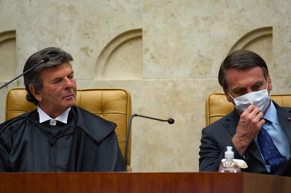 BRASILIA, BRAZIL - SEPTEMBER 10: (L-R) The new Supreme Court President Luiz Fux and President of Brazil Jair Bolsonaro attend the inauguration ceremony of the Supreme Court President amidst the coronavirus (COVID-19) pandemic at the on September 10, 2020 in Brasilia. Brazil has over 4.197,000 confirmed positive cases of Coronavirus and has over 128,539 deaths. (Photo by Andressa Anholete/Getty Images)