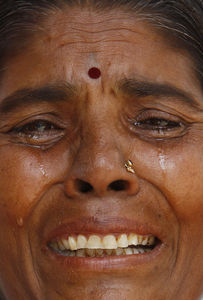 An unidentified devotee grieves on hearing the news of the Hindu holy man Sathya Sai Baba's death, outside Baba's ashram in Puttaparti, about 450 kilometers (281 miles) from Hyderabad, India, Sunday, April 24, 2011. A doctor says Hindu holy man Sathya Sai Baba, considered a living god by followers, has died. He was 86.
