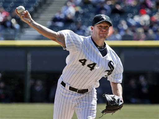 Chicago White Sox starting pitcher Jake Peavy delivers during the first inning of a baseball game against the Kansas City Royals, Wednesday, April 3, 2013, in Chicago. (AP Photo/Charles Rex Arbogast)