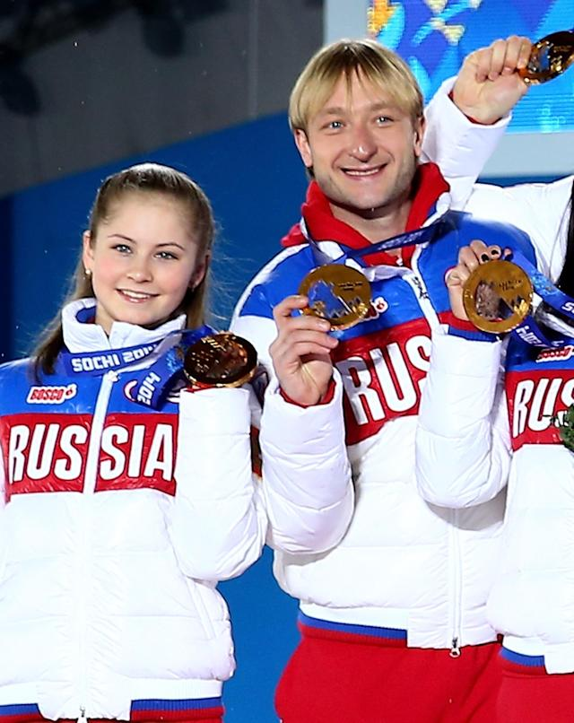 SOCHI, RUSSIA - FEBRUARY 10: Gold medalists Yulia Lipnitskaya (L) and Evgeny Plyushchenko of Russia celebrate during the medal ceremony for the Team Figure Skating Overall on day 3 of the Sochi 2014 Winter Olympics at Medals Plaza in the Olympic Park on February 10, 2014 in Sochi, Russia. (Photo by Streeter Lecka/Getty Images)