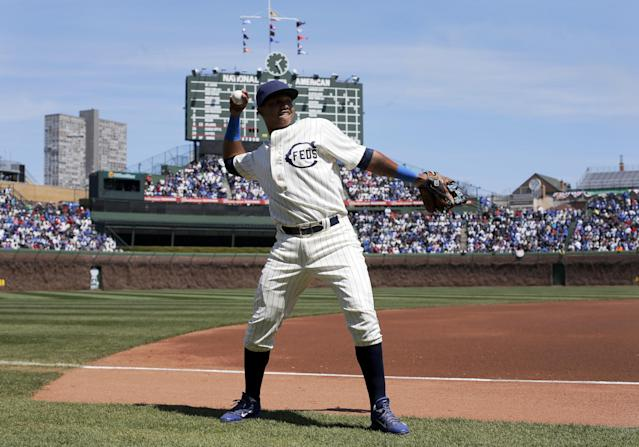 Chicago Cubs shortstop Starlin Castro warms up in a replica 1914 Chicago Federals jersey on the 100th anniversary of the first baseball game at Wrigley Field, before a game between the Cubs and Arizona Diamondbacks, Wednesday, April 23, 2014, in Chicago. (AP Photo/Charles Rex Arbogast)