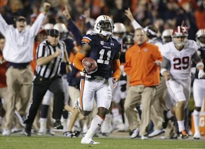 Auburn's Chris Davis returns Alabama's missed field goal 109 yards for a game-winning TD in 2013. (AP)