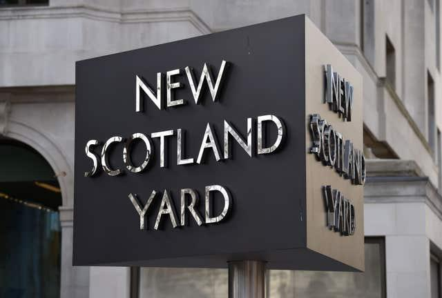 The New Scotland Yard sign outside the headquarters of the Metropolitan Police (KIrsty O'Connor/PA)