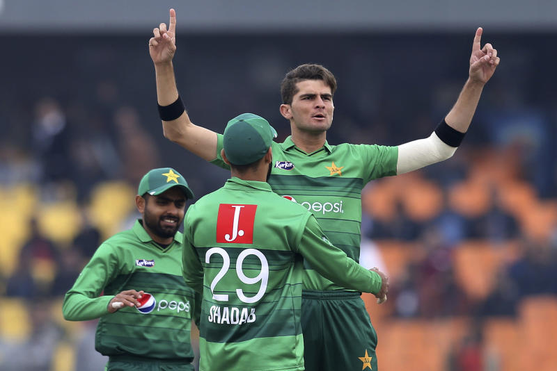 Pakistan pacer Shaheeh Shah Afridri, center, celebrates with teammates after taking the wicket of Bangladesh batsman Mohammad Naim during the second T20 cricket match at Gaddafi stadium, in Lahore, Pakistan, Saturday, Jan. 25, 2020. (AP Photo/K.M. Chaudary)