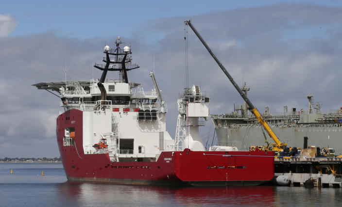 FILE - In this March 30, 2014 file photo, Australian navy ship Ocean Shield lies docked at naval base HMAS Stirling while being fitted with a towed pinger locator to aid in her roll in the search for missing Malaysia Airlines Flight MH370 in Perth, Australia. After nearly three years, the hunt for Malaysia Airlines Flight 370 ended in futility and frustration on Tuesday, Jan. 17, 2017, as crews completed their deep-sea search of a desolate stretch of the Indian Ocean without finding a single trace of the plane. (AP Photo/Rob Griffith, File)