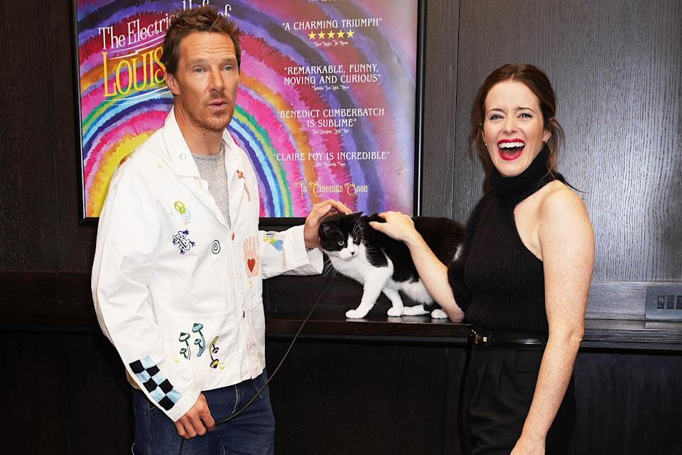 <p>Benedict Cumberbatch and Claire Foy pose with one of their furry costars at the screening of <em>The Electrical Life of Louis Wain</em> in London on Oct. 10.</p>