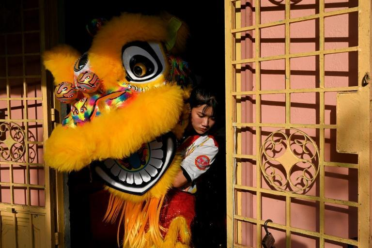 Nguyen Thuy Huong,17 is one of the 20 women in the Tu Anh Duong lion and dragon dance troupe in Can Tho city in southern Vietnam