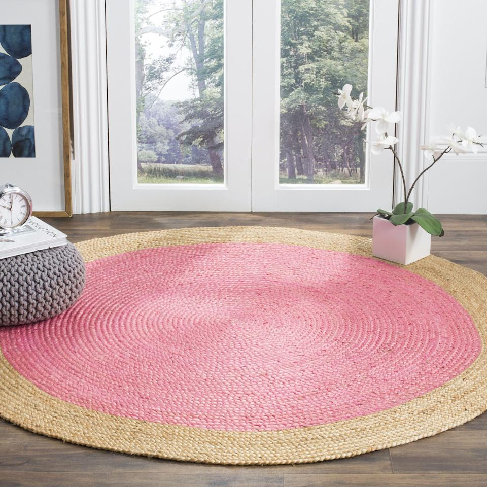 "<h3>Braided Jute Area Rug</h3><p>Add a pop of color to your space in an unexpected way with this braided jute rug that was handwoven in India.</p><br><br><strong>Safavieh</strong> Natural Fiber Cebrail Braided Area Rug (5' x 5'), $68.98, available at <a href=""https://www.walmart.com/ip/Safavieh-Natural-Fiber-Cebrail-Braided-Area-Rug/953833906"" rel=""nofollow noopener"" target=""_blank"" data-ylk=""slk:Walmart"" class=""link rapid-noclick-resp"">Walmart</a>"