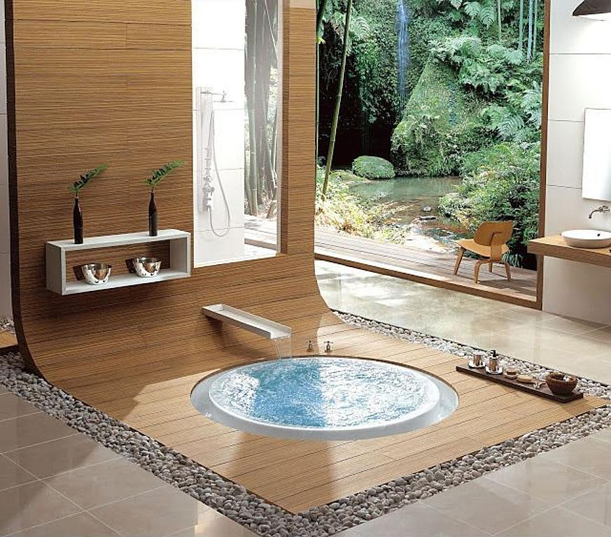 Zen Oasis With its smooth river rock border and cool stream faucet, this soaking tub is designed for just one.