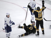 Boston Bruins right wing Brett Ritchie (18) raises his arms after his goal during the third period of an NHL hockey game against the Toronto Maple Leafs in Boston, Tuesday, Oct. 22, 2019. On the ice looking up is Bruins left wing Jake DeBrusk, and at left is Maple Leafs right wing Kasperi Kapanen. (AP Photo/Charles Krupa)