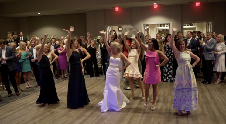 An ex-cheerleader who's a bride and her former squad performed a show-stopping dance at the bride's wedding. (Photo: Al.com)