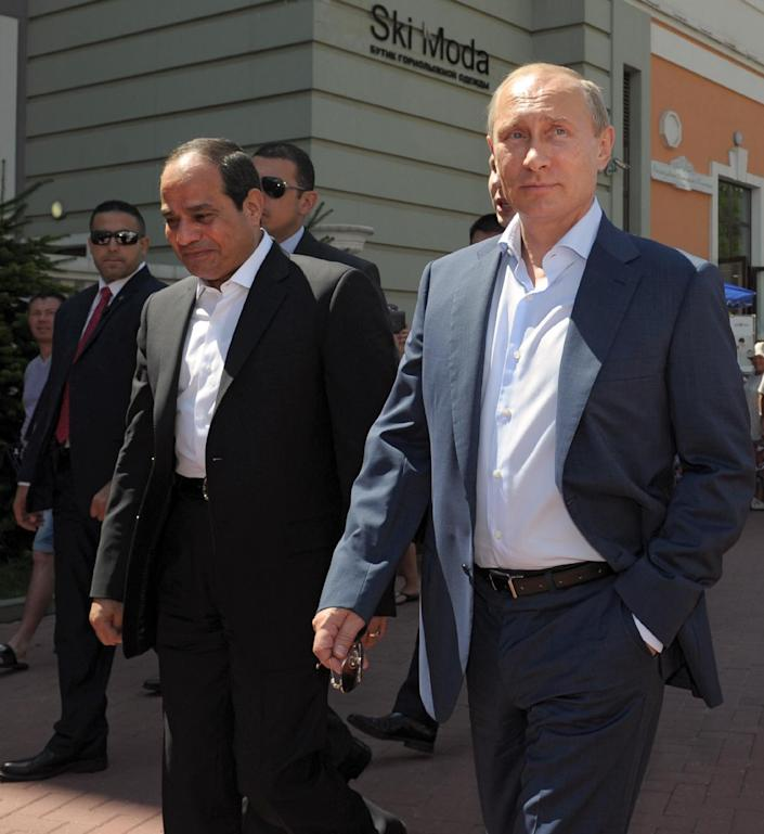 Russian President Vladimir Putin (R) and his Egyptian counterpart Abdel Fattah al-Sisi (L) walk on the main embankment in the Roza Khutor Village outside Sochi on August 12, 2014 during the Egyptian leader's first official visit to Russia (AFP Photo/Alexei Druzhinin)
