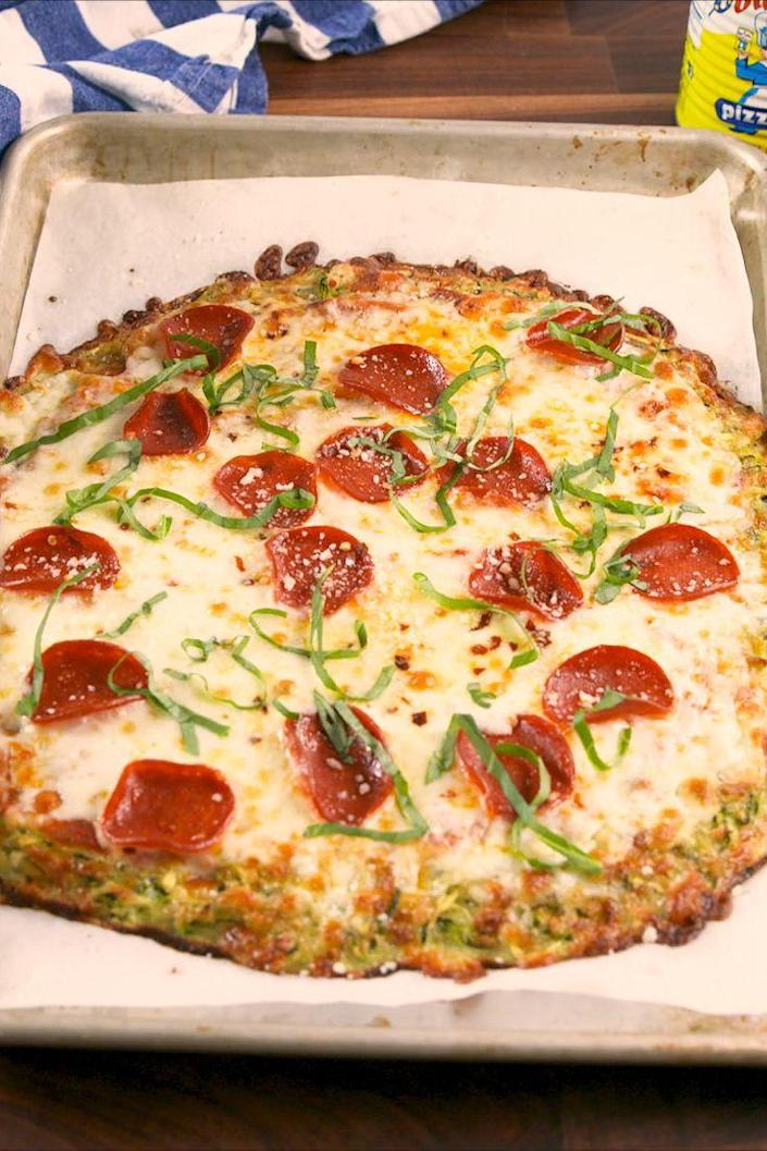 """<p>Have your pizza and your diet too.</p><p>Get the recipe from <a href=""""https://www.delish.com/cooking/recipe-ideas/recipes/a58080/zucchini-pizza-crust-recipe/"""" rel=""""nofollow noopener"""" target=""""_blank"""" data-ylk=""""slk:Delish"""" class=""""link rapid-noclick-resp"""">Delish</a>.</p>"""