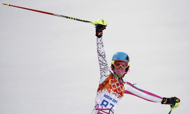 Lebanon's Jacky Chamoun celebrates after completing the first run of the women's slalom at the Sochi 2014 Winter Olympics, Friday, Feb. 21, 2014, in Krasnaya Polyana, Russia. (AP Photo/Christophe Ena)